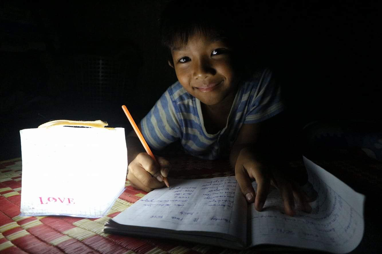 solight child reads by solar powered lantern